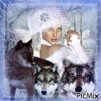 La femme et ses loups en hiver.