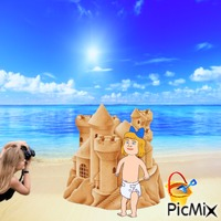 Baby, sandcastle and photographer